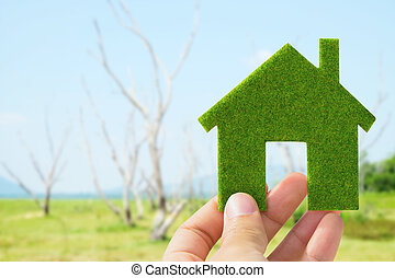 eco house icon concept - Hand holding eco house icon concept