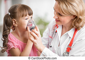Pediatrician doctor making inhalation to kid patient -...