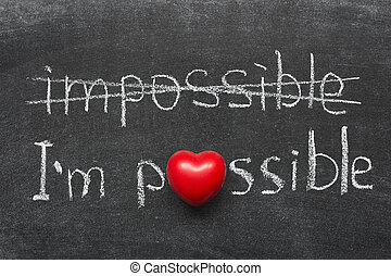 I am possible concept handwritten on blackboard with heart...