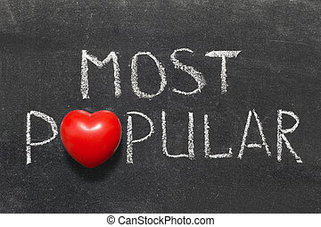 most popular phrase handwritten on blackboard with heart...