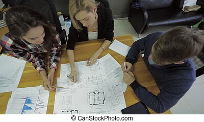 a group of electricians, each blueprint discusses the...