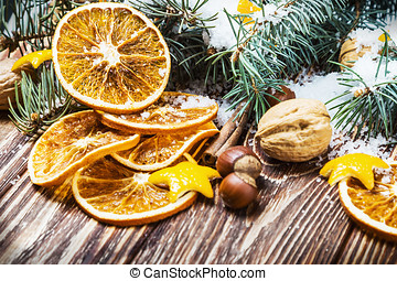 dried oranges with nuts and fir branches - dried oranges...