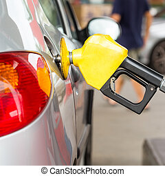 Fuel station service fill energy into your car at gas...