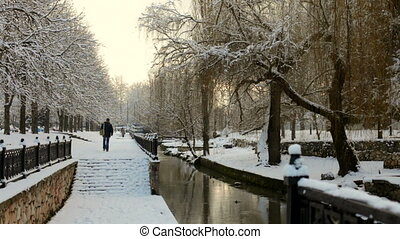 Casual Passers Walking In Beautiful Park At Wintertime -...