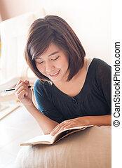 Young asian woman writing diary - Young asian woman writing...