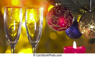 christmas tree with two glasses and pouring champagne in...