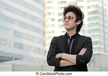 Confident businessman look and think in the outside office...