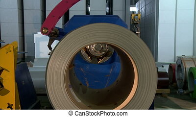 Coil of production material placing on machine - Coil of...