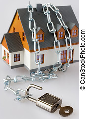 family house and metallic chain as a protection - key lock...