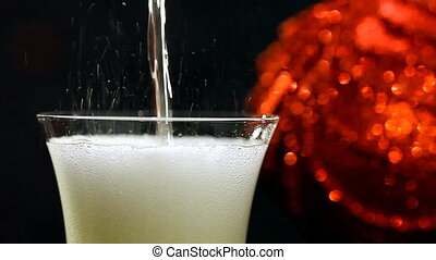 Pouring a glass of champagne - spilling a glass of...