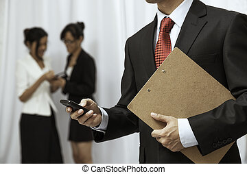 businessman using his cellphone - businessman using his...