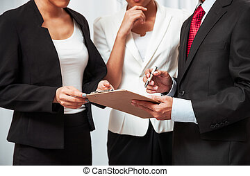 business people discussing work - three business people...