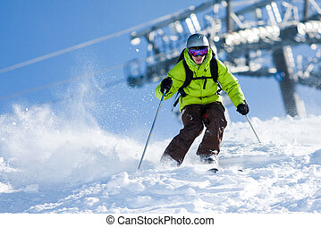 Off-piste skiing - Young man on skis out of slopes Off-piste...