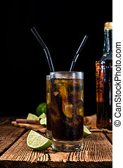 Cold Longdrink (Cuba Libre) with brown rum and fresh lime on...