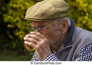 Old Man With a Grey Beard drinking a glass of wine, selected...