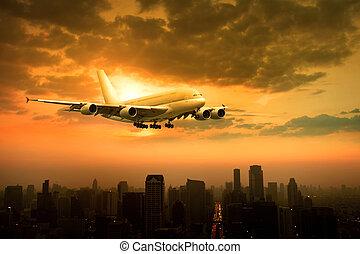 passenger jet plane flying over urban scene against...