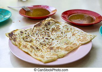 indian roti or Roti canai with curry sauce