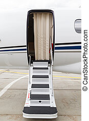 ladder in a private jet - white private jet and open ladder...