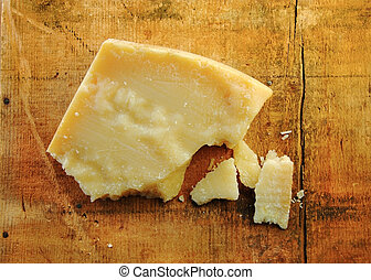 Parmesan Cheese Chunks on Wood - Parmesan cheese chunks on a...