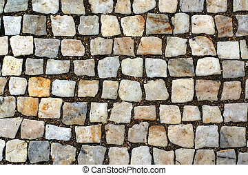 Stone blocks of sidewalk