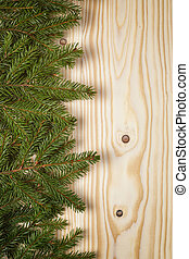 green fir border over pine wood