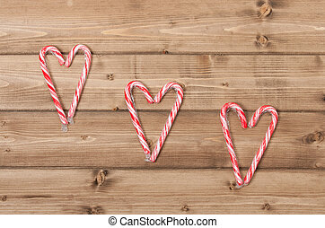Christmas Background. Candy Canes, Heart Shape. Wooden Table...