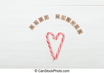 Christmas Background. Candy Canes, Heart Shape. Best Wishes...