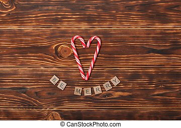 Christmas Background. Candy Canes, Heart Shape. Be Merry...