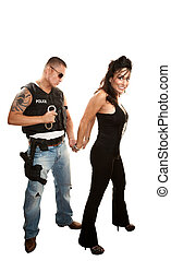 Hispanic cop arresting pretty woman - Hispanic cop arresting...