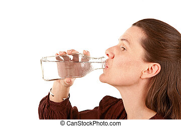 Woman Drinking Water - Pretty adult woman drinking water...