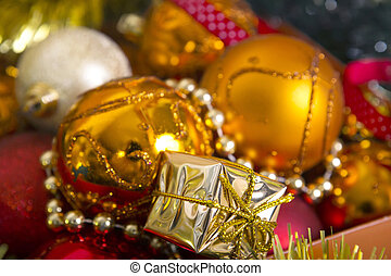 Colored christmas balls in a box. - Nice golden and red...