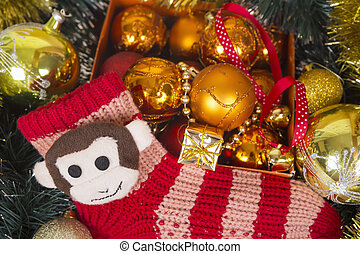 Christmas background with colored balls and monkey on red...