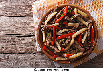 Peruvian cuisine: Lomo saltado on a plate. horizontal top...