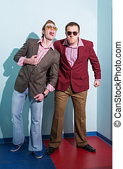 two guys with glasses and retro costumes. portraits