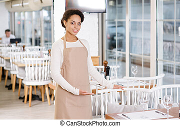 Waitress offering a seat. - Polite service. Pleasant young...