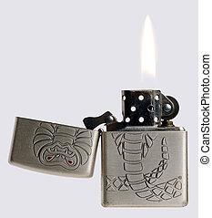 petrol cigar-lighter - old petrol cigar-lighter with a lit...