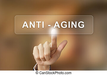 business hand clicking anti aging button on blurred...