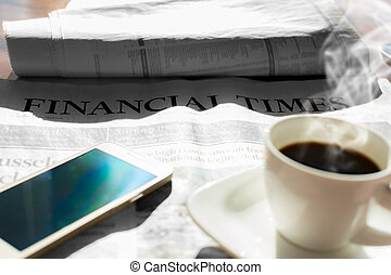 Newspaper with coffee - Coffee and cell phone and newspaper...
