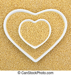Couscous in heart shaped bowls forming an abstract...