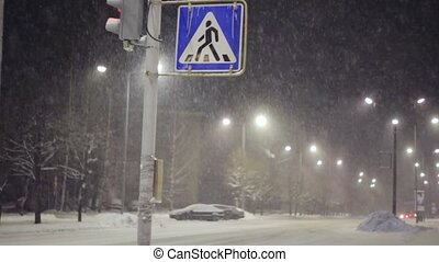 Pedestrian crossing sign during heavy snowstorm