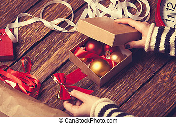 Female hands and christmas gift box - Female hands are...
