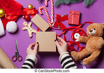 hands are wrapping a christmas gift - Female hands are...