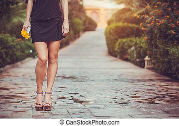 female legs in purple shoes walking in the park - Beautiful...