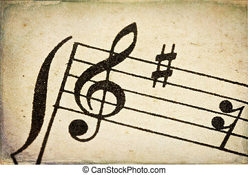 treble clef on vintage music sheet - treble clef - macro of...
