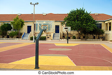 Basketball court in the backyard of the school.