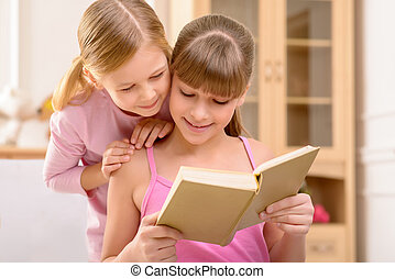 Cheerful sisters reading book - We love fairy tales Nice...