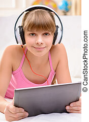 Cheerful little girl listening to music - Time for resting....