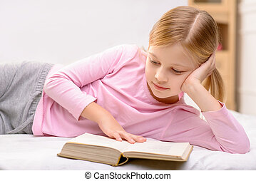 Pretty little girl reading - Want to be smart Pleasant...