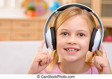 Vivacious little girl listening to music - My favorite song....