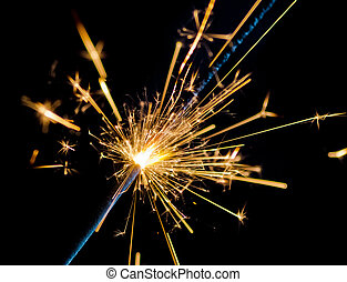 firework sparkler burning on black background, congratulation greeting  party happy new year,  christmas celebration